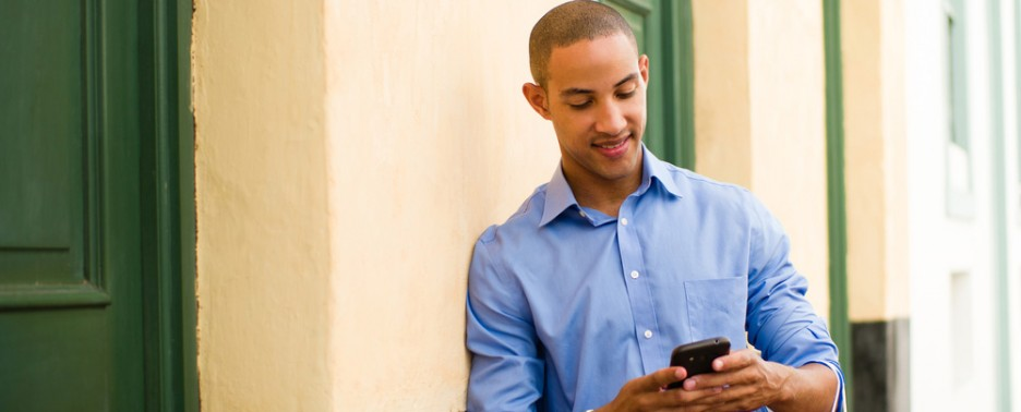 Young man banking from his mobile device